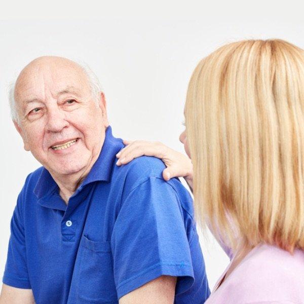 Older man talking to nurse